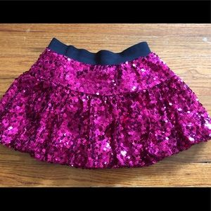 Justice pink sequined skirt with built shorts.